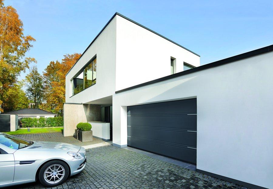 Funkcjonalny, bezpieczny i ciepły garaż. Segmentowe bramy garażowe firmy Hörmann